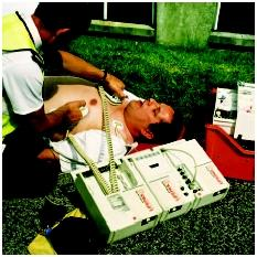 A portable defibrillator is used in an attempt to revive a man who had a heart attack before he is transported to an emergency room. (Photograph by Adam Hart-Davis. Science Source/Photo Researchers. Reproduced by permission.)