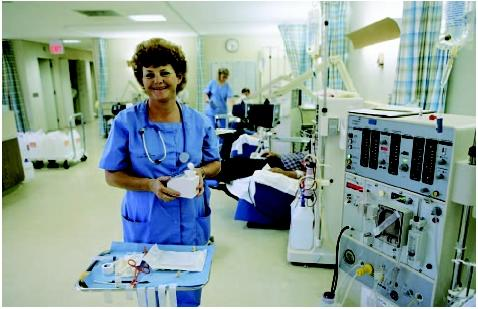 Nurse working in a kidney dialysis unit. (Custom Medical Stock Photo. Reproduced by permission.)